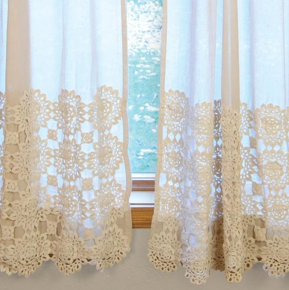 Hand crocheted medallions on a cream colored linen curtain