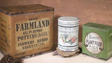Vintage country tins and crates on a table top