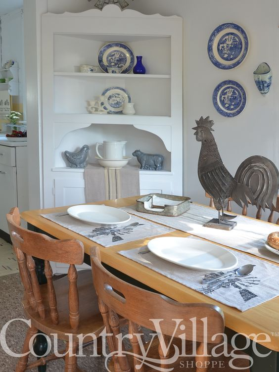 Sawyer Mill placemats and white oval china dishes with a metal rooster table decoration