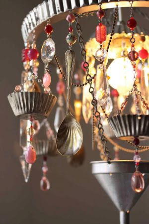 Chandelier mixing galvanized antique tin with colored glass beads and antique silverware