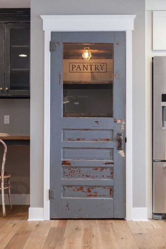 Gray chipped wooden door with glass insert
