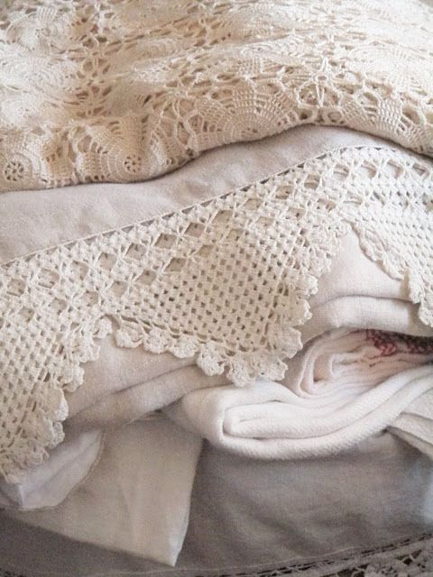 Vintage white crocheted border on white cotton fabric bed linens
