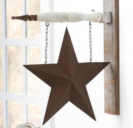 Hanging arrow sign with rusted tin star on a front porch