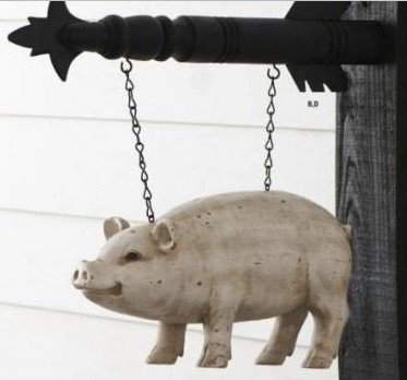 Black hanging arrow with pig sign
