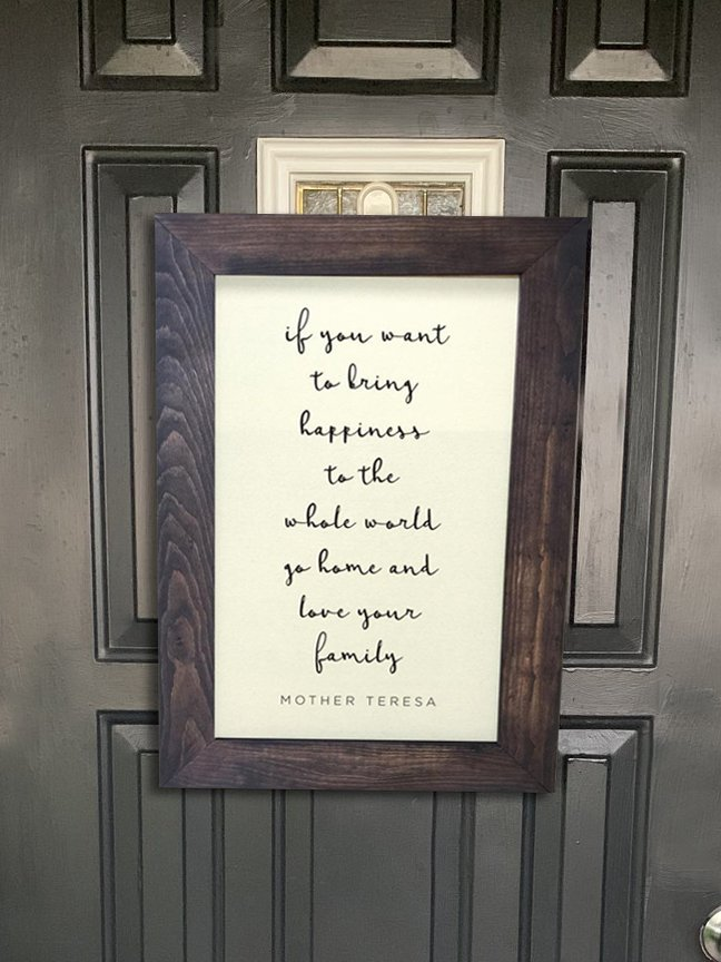 Framed caligraphy as a front door decoration on a black front door