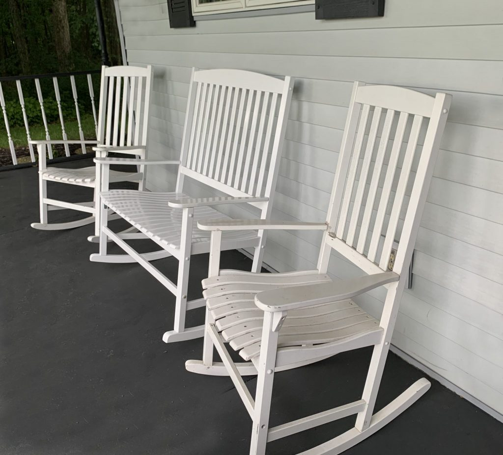 Grouping of white wooden porch rockers